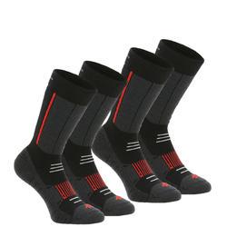 Chaussettes de randonnée neige adulte SH520 x-warm mi-hauteur noires rouge.