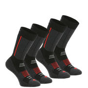 Črne in rdeče srednje visoke pohodniške nogavice SH520 za odrasle