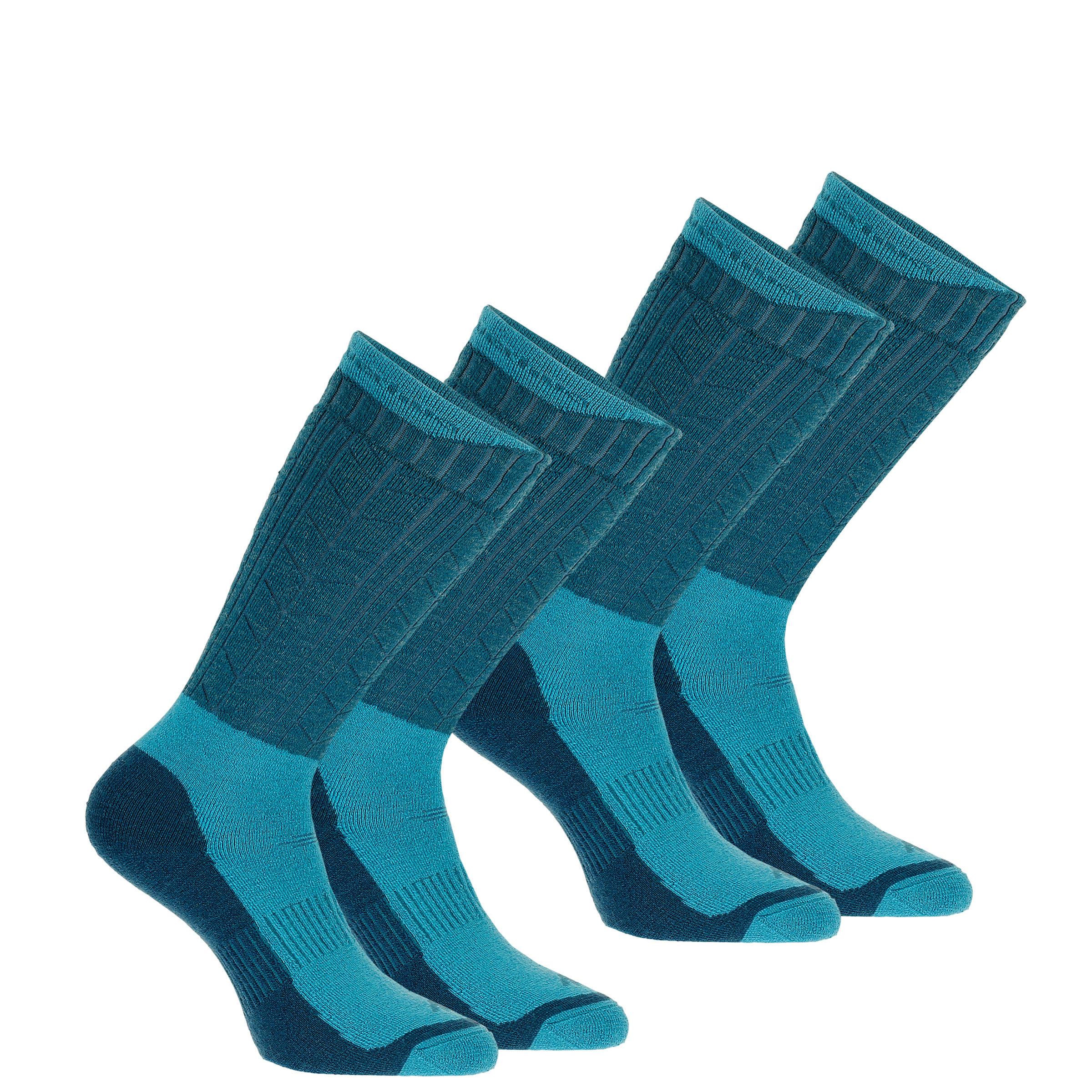 Chaussettes de randonnée neige adulte SH500 ultra-warm mi-hauteur bleues.