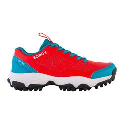 Chaussures de hockey adolescent intensité faible à moyenne FH100 rouge bleu