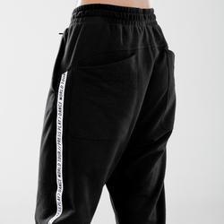 Pantalon danses urbaines carrot noir à bandes blanches femme