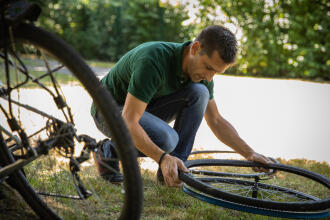 Man changing a bicycle inner tube