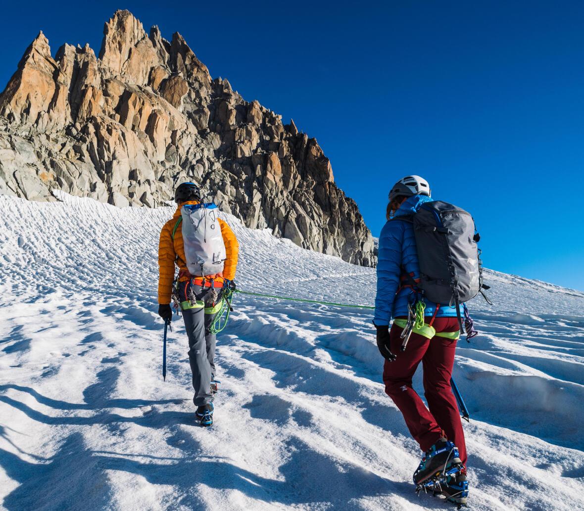 two alpinist glacier hiking