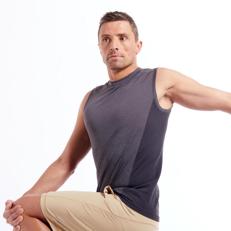 Mouwloos shirt voor yoga heren naadloos grijs