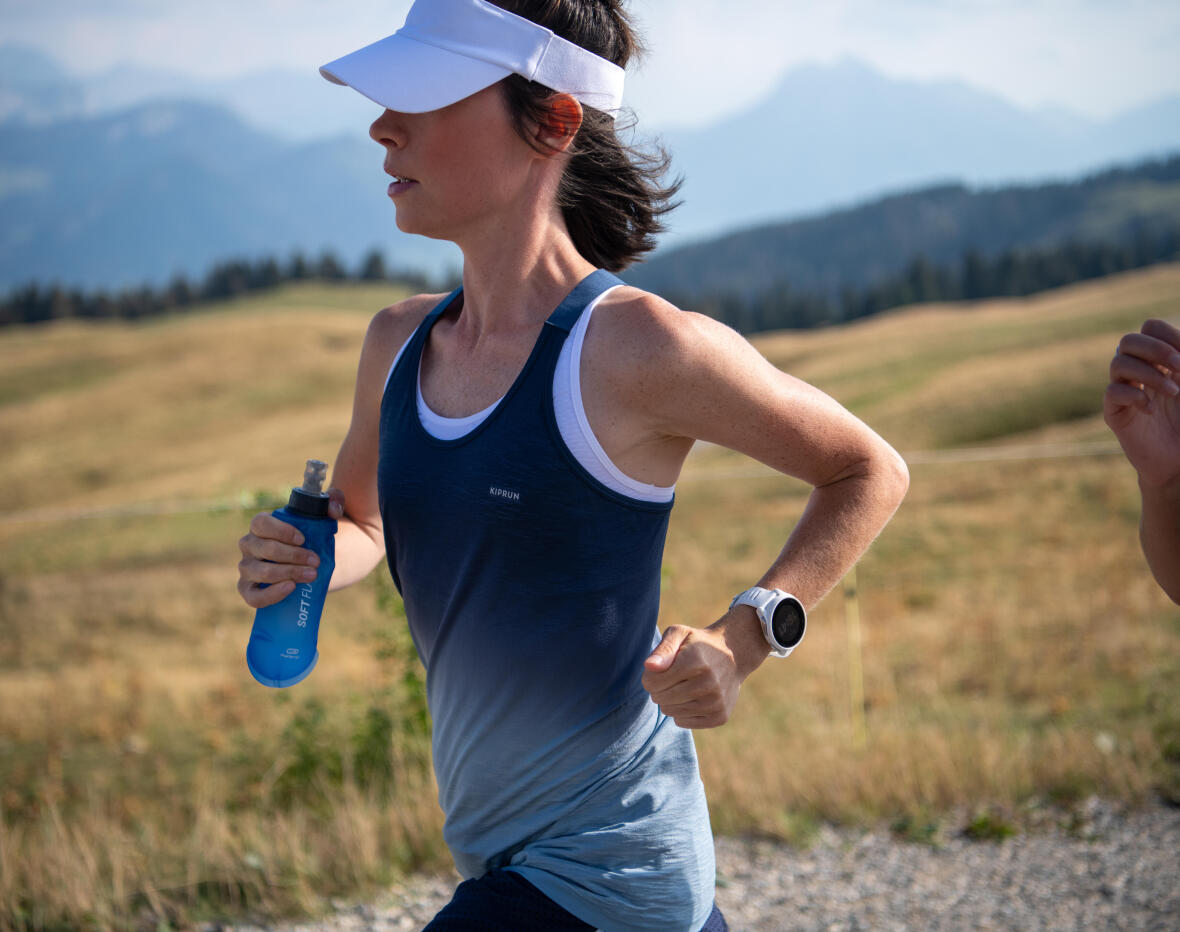 woman running with her water bottle