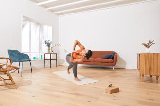 a woman doing yoga in her living room