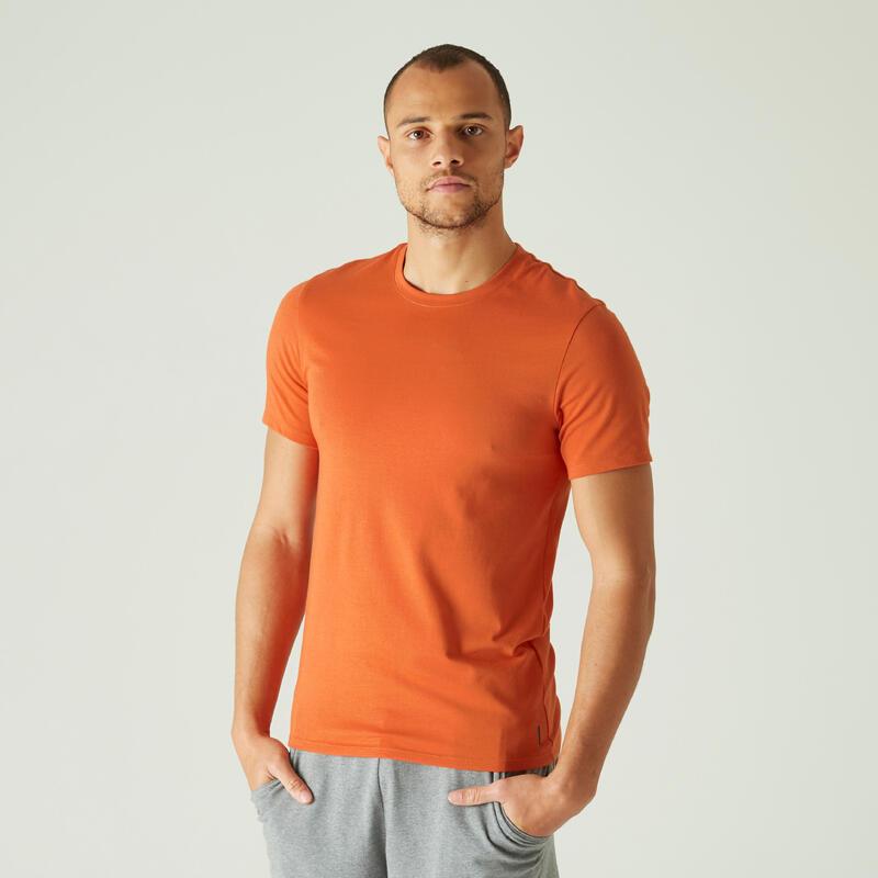 T-shirt voor pilates en lichte gym heren 500 rekbaar katoen slim fit oranje