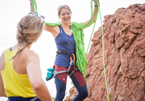woman climbing with rope