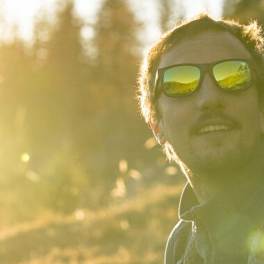 How should you clean your sunglasses?