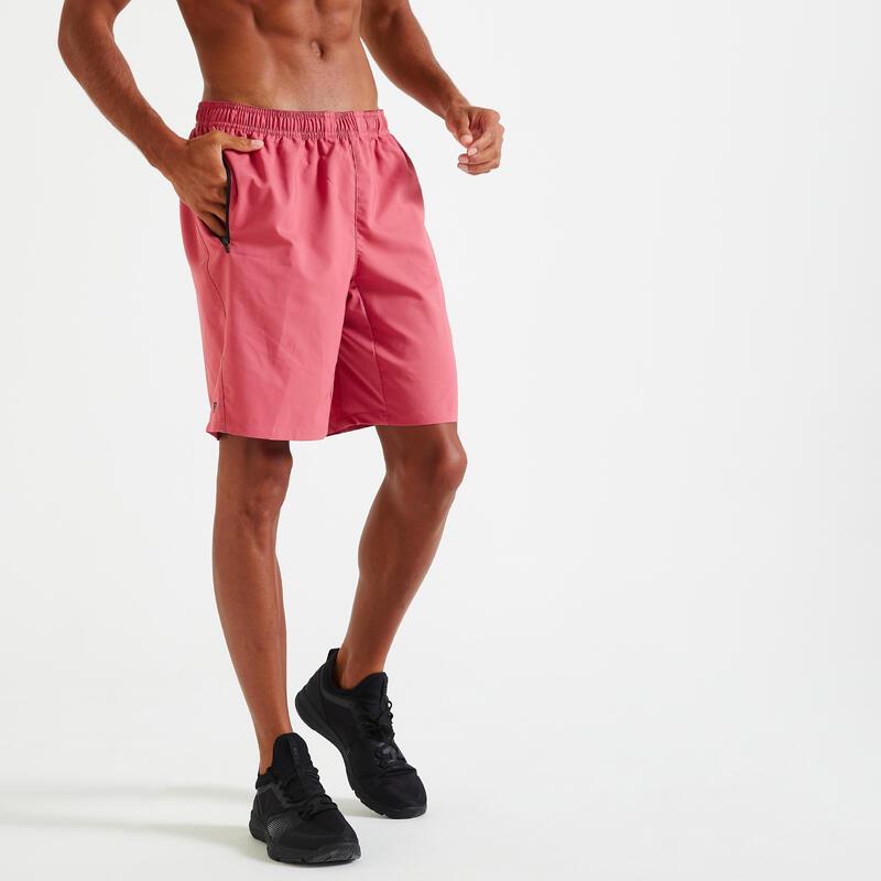 Short Fitness training rose uni poches zippées
