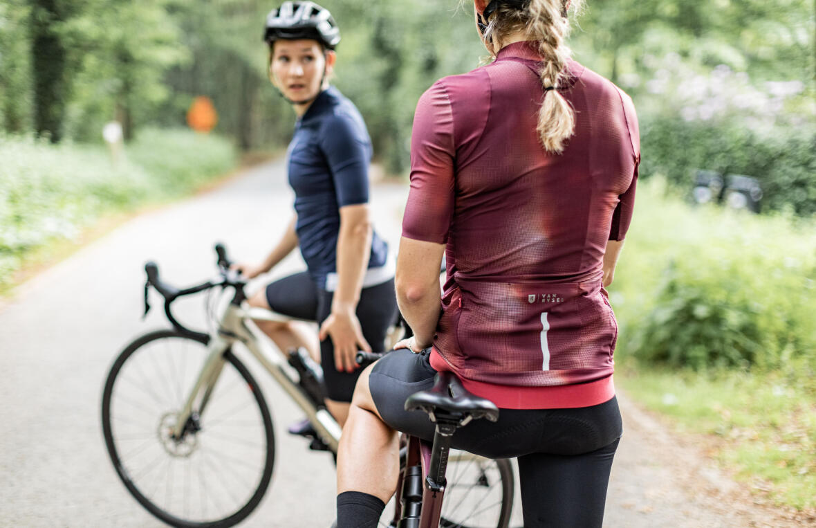 woman on her touring bike talking with another cyclist