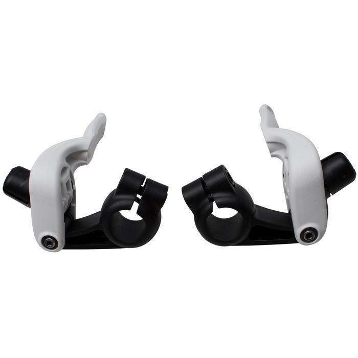 Un par de palancas de freno STOP EASY para una bicicleta infantil.