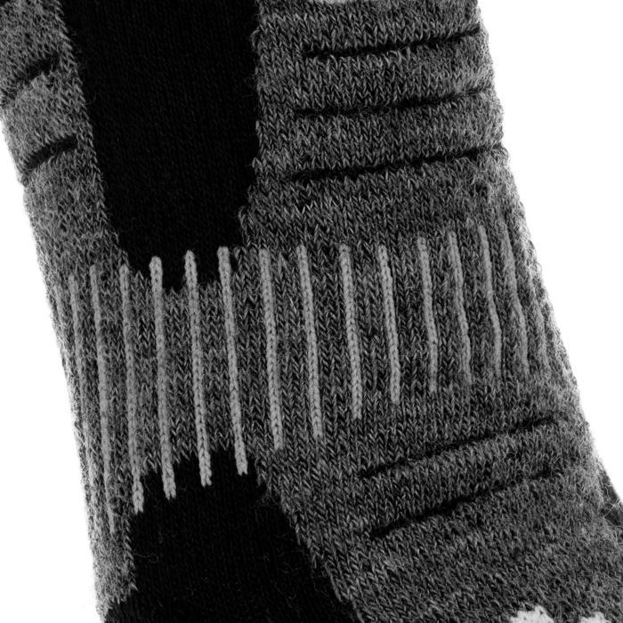 Calcetines de senderismo nieve adulto SH520 x-warm high negro rojo.