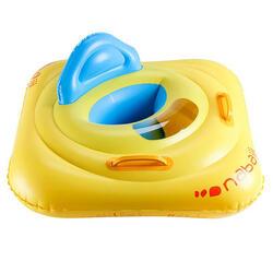 Een gele zitband met venstertje en handgrepen, voor kinderen van 7 tot 11 kg