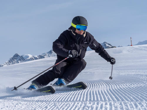 How do you put goggles on with a ski helmet?