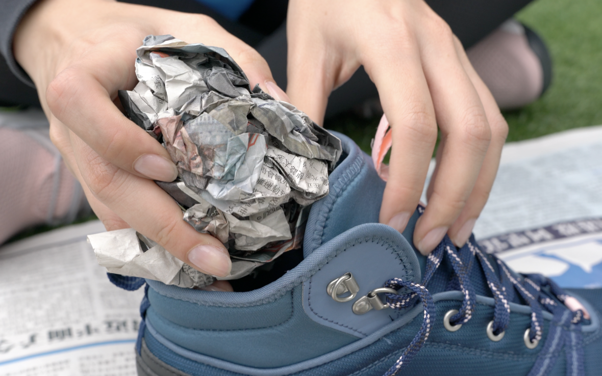 Use newspaper to dry hiking shoes