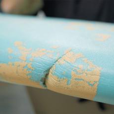 réparer une coupure ou entaille d'aileron sur une planche de surf en mousse