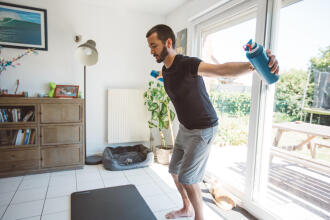 man stretching at home
