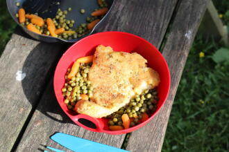 Breaded fish with peas and carrots